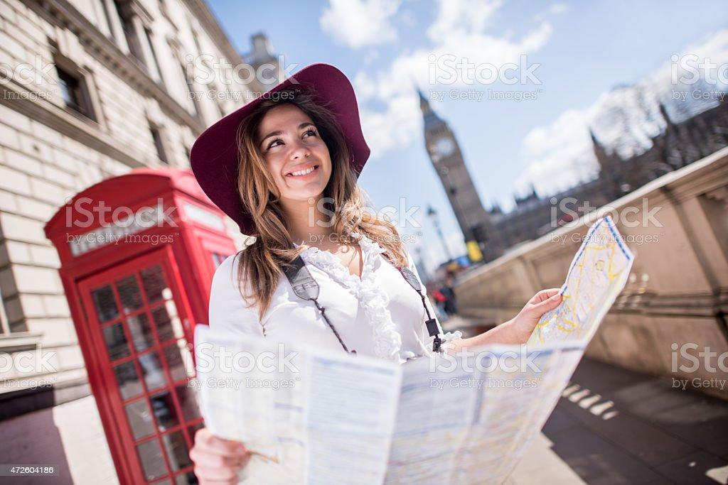 Tourist in London holding a map stock photo