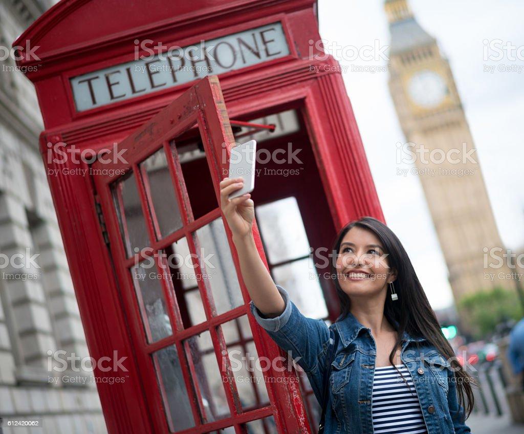Tourist in London taking a selfie stock photo