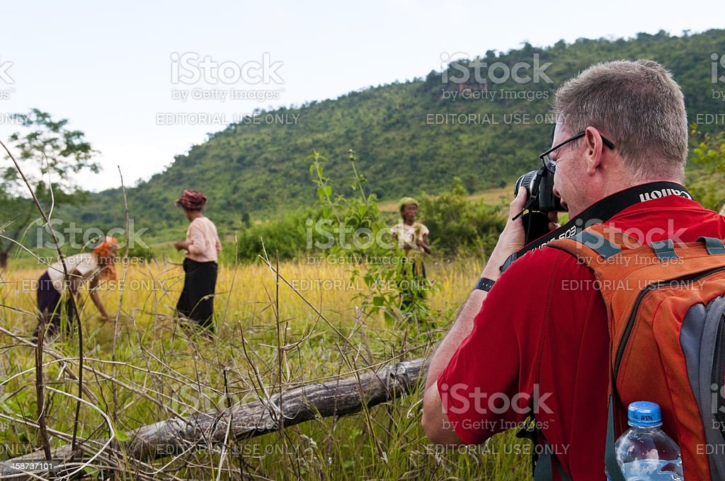 Canon photographer in the field stock photo
