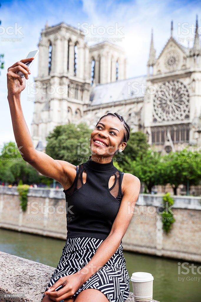 Tourist in Paris, selfie in Notre Dame stock photo