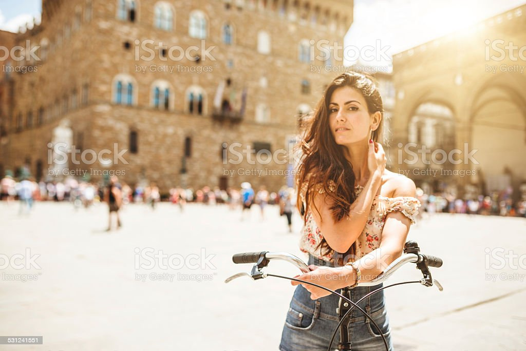 Tourist in piazza della signoria with a bike - florence stock photo
