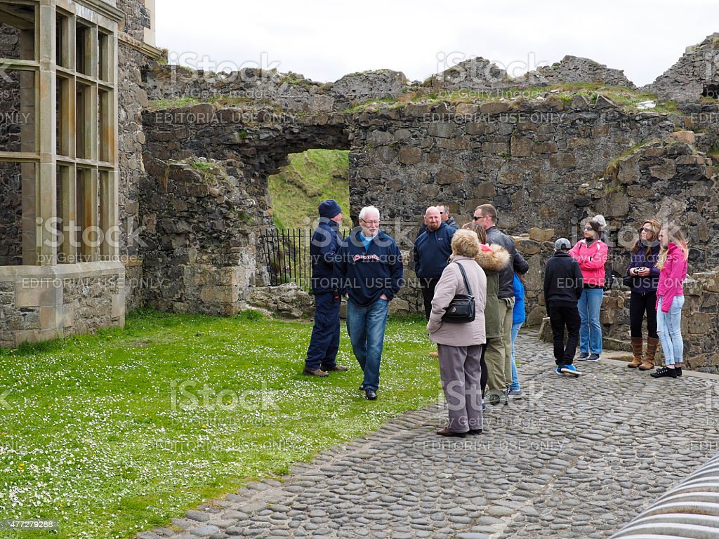 tourist in the dunlunce castle stock photo