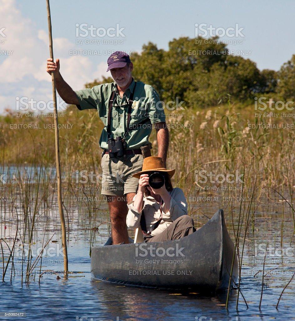 Tourist in the Okavango Delta - Botswana stock photo