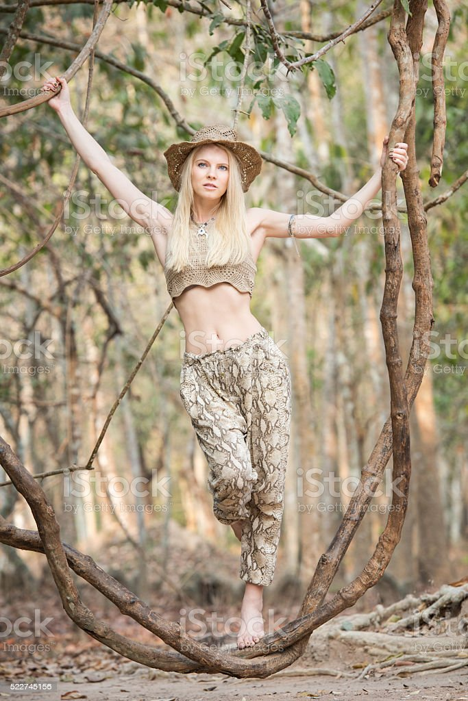 Tourist in the Rain Forest swinging on a Vine stock photo
