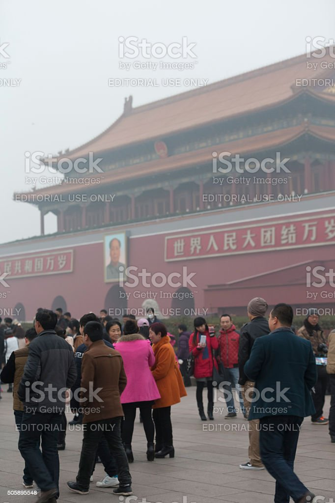 Tourist in Tiananmen Square under a heavy smog day, Beijing stock photo