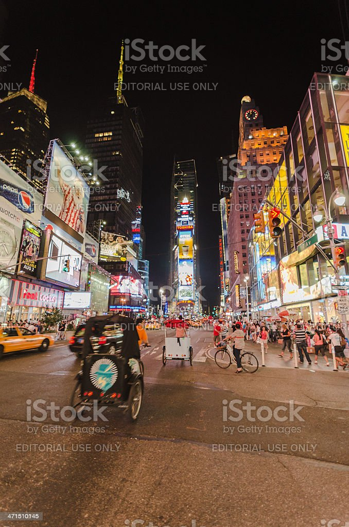Tourist in Times Square and illuminated skyscraper royalty-free stock photo