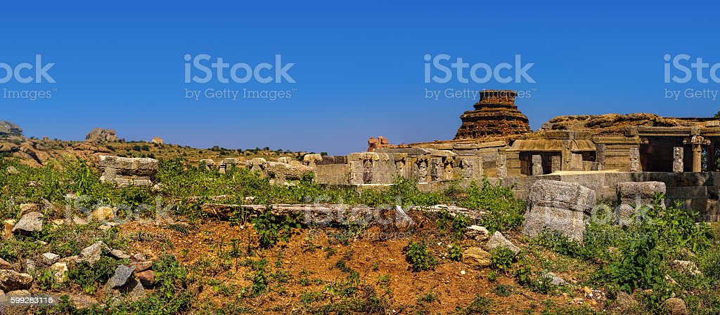 Tourist Indian landmark Ancient ruins in Hampi. stock photo