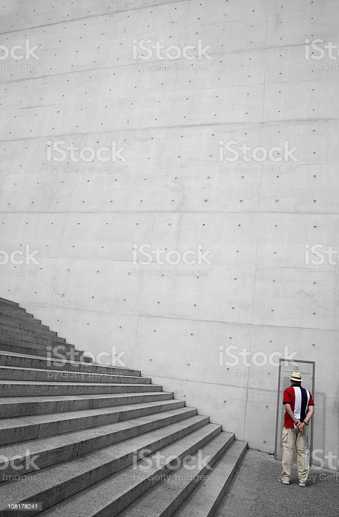 tourist infront of concrete wall royalty-free stock photo