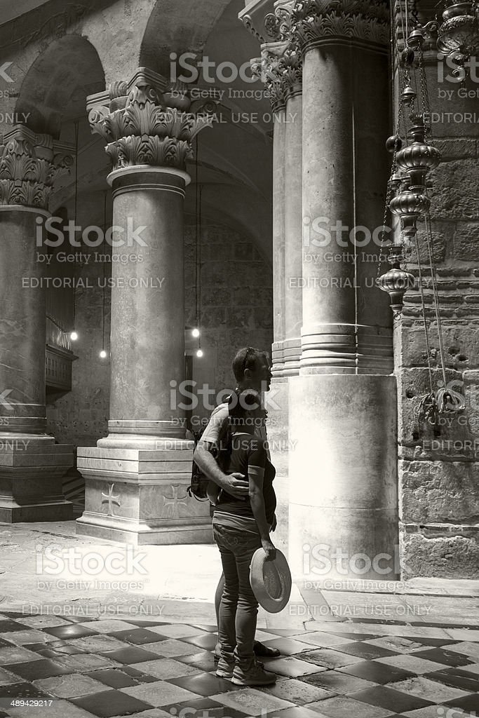 Tourist inside Church of the Holy Sepulchre, Jerusalem royalty-free stock photo