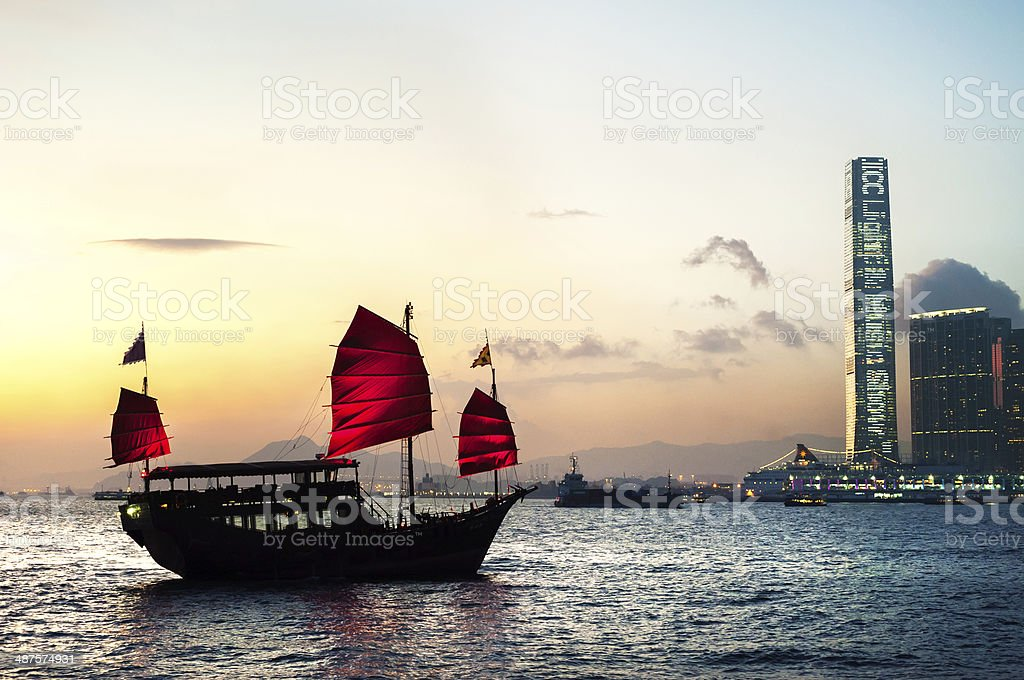 Tourist junk crossing Victoria Harbour, Hong Kong stock photo