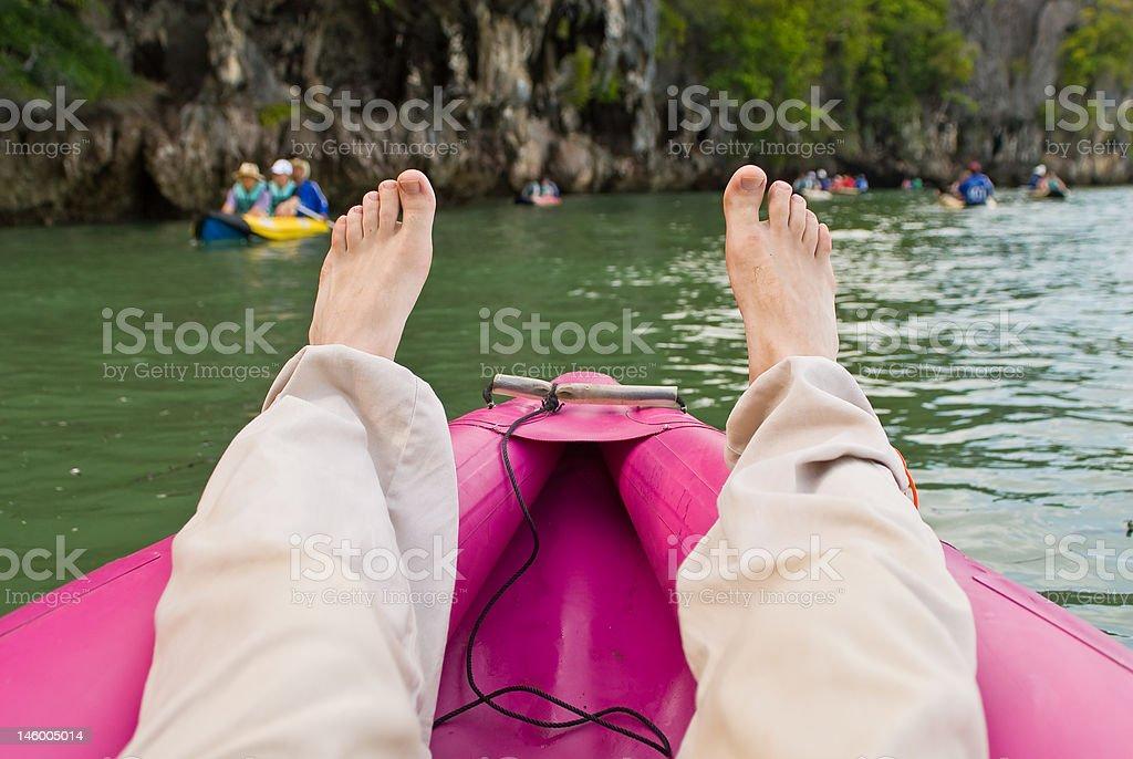 tourist legs at sea canoe royalty-free stock photo