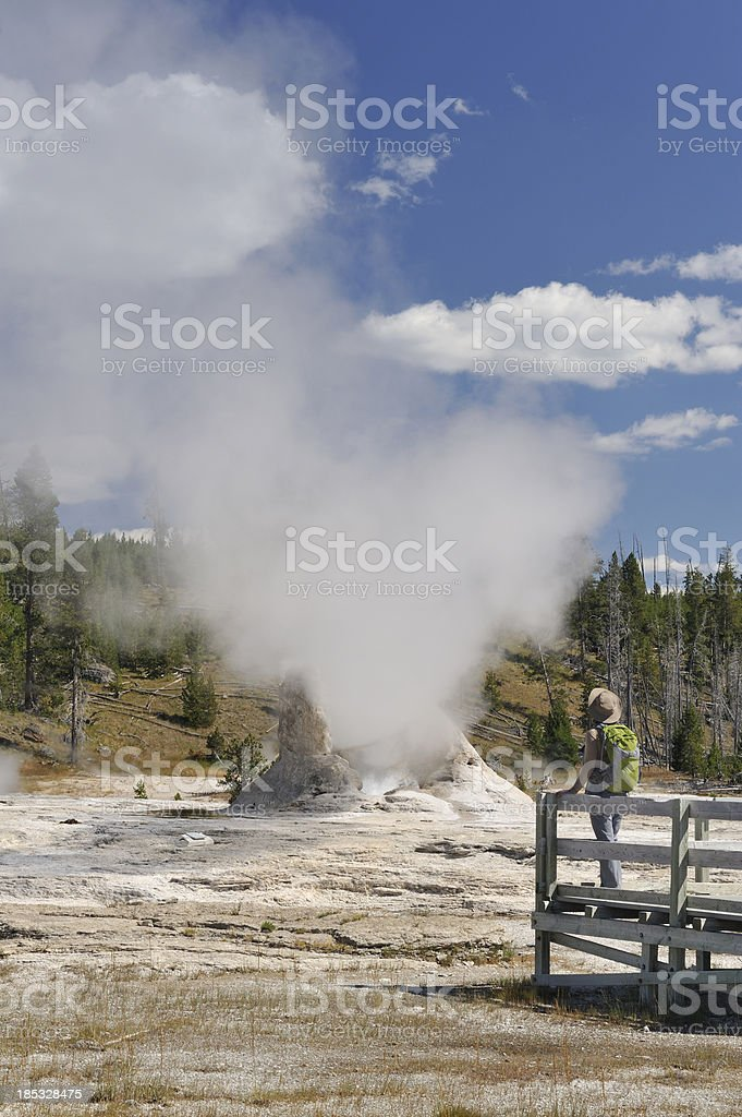 Tourist looking at geyser stock photo