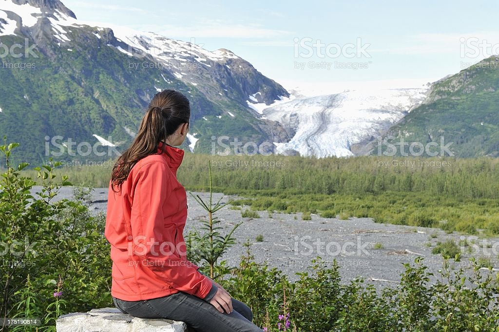 Tourist looking at glacier stock photo