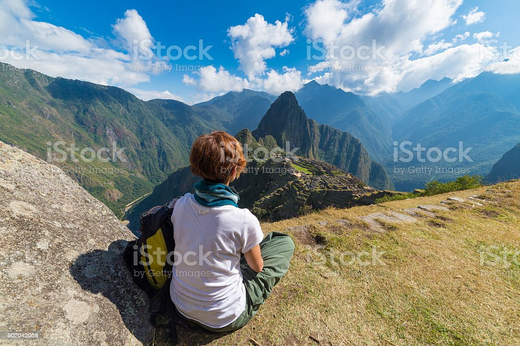 Tourist looking at Machu Picchu from above, Peru stock photo