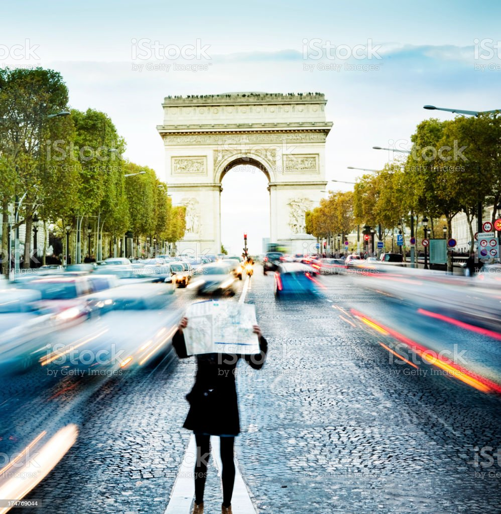 Tourist looking at map in Paris royalty-free stock photo
