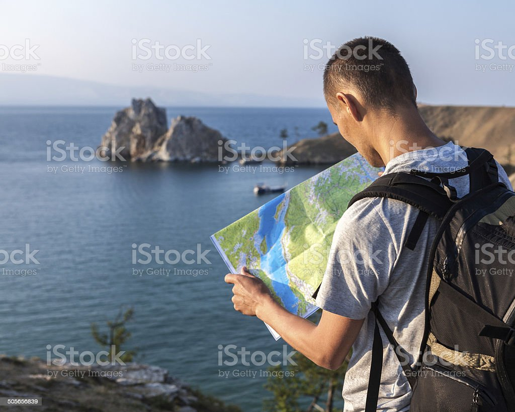 Tourist looking at map stock photo