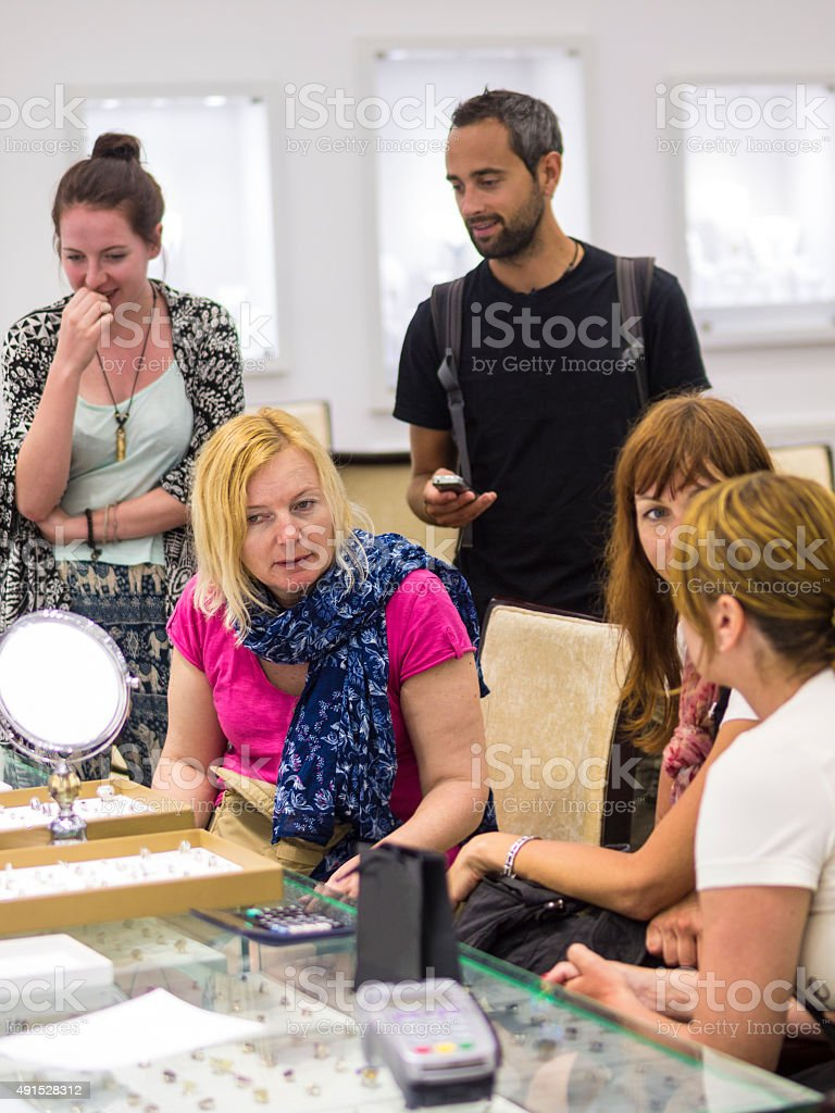 Tourist looking at rings with gemstones, Sri lanka stock photo