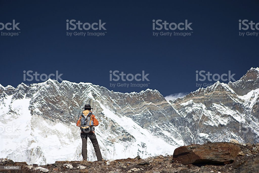 Tourist looking at South Face of Lhotse stock photo
