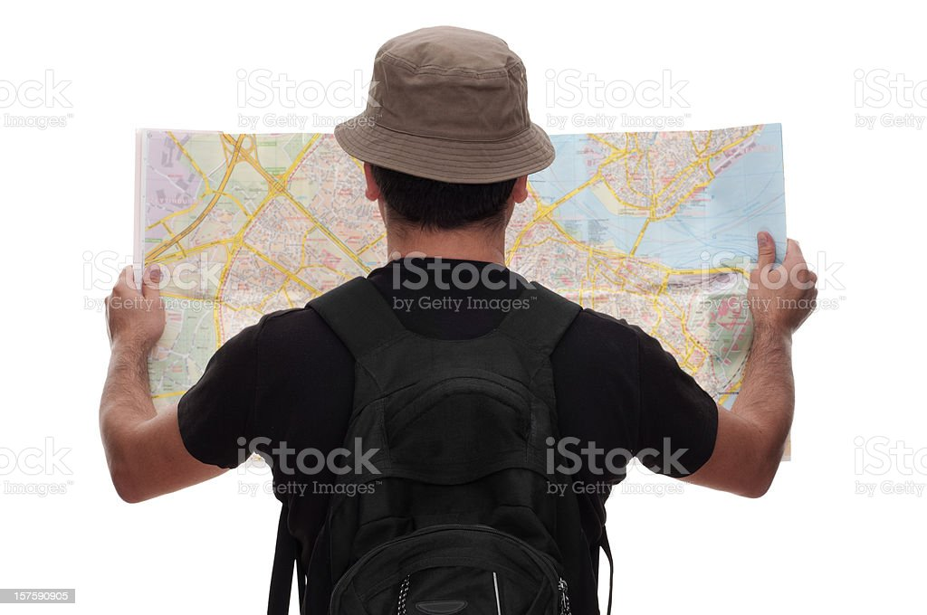 Tourist looking at the map stock photo