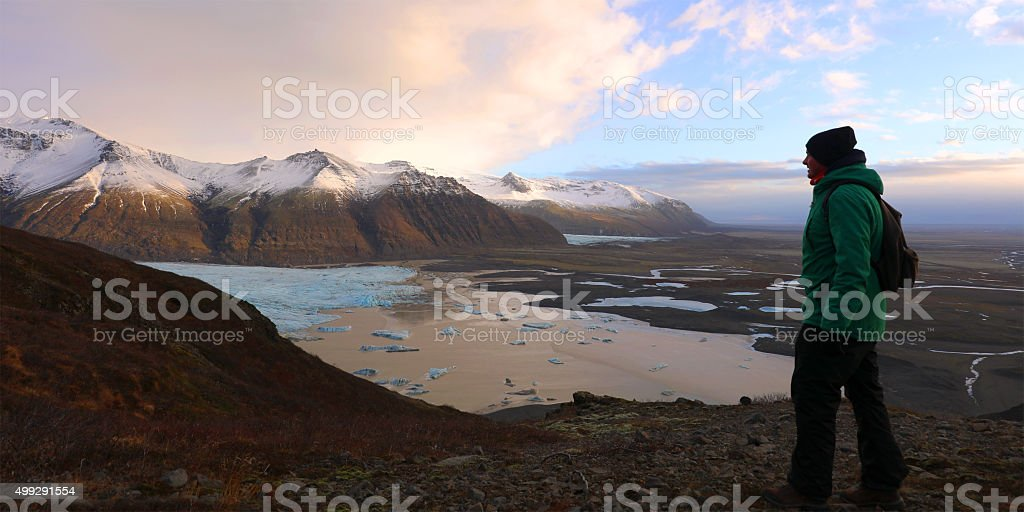 Tourist Looking at View in Skaftafell NP Iceland stock photo