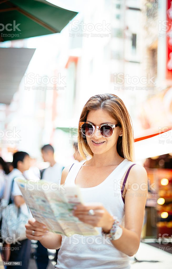 Tourist looking for landmarks in city in Japan stock photo