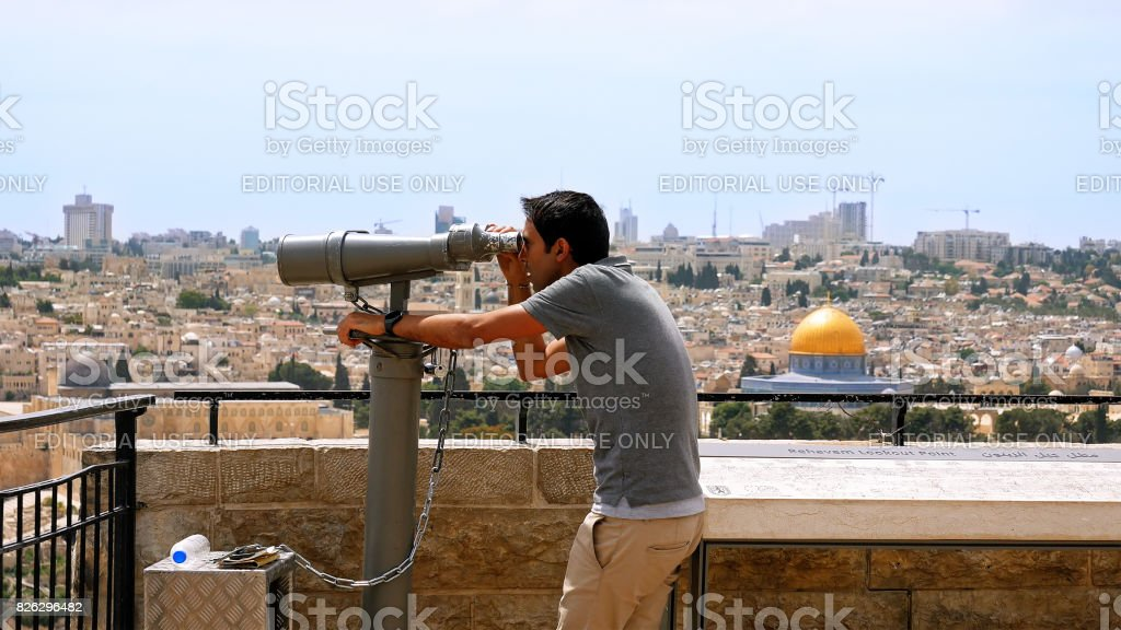 Tourist looks at the Jerusalem Old City view stock photo