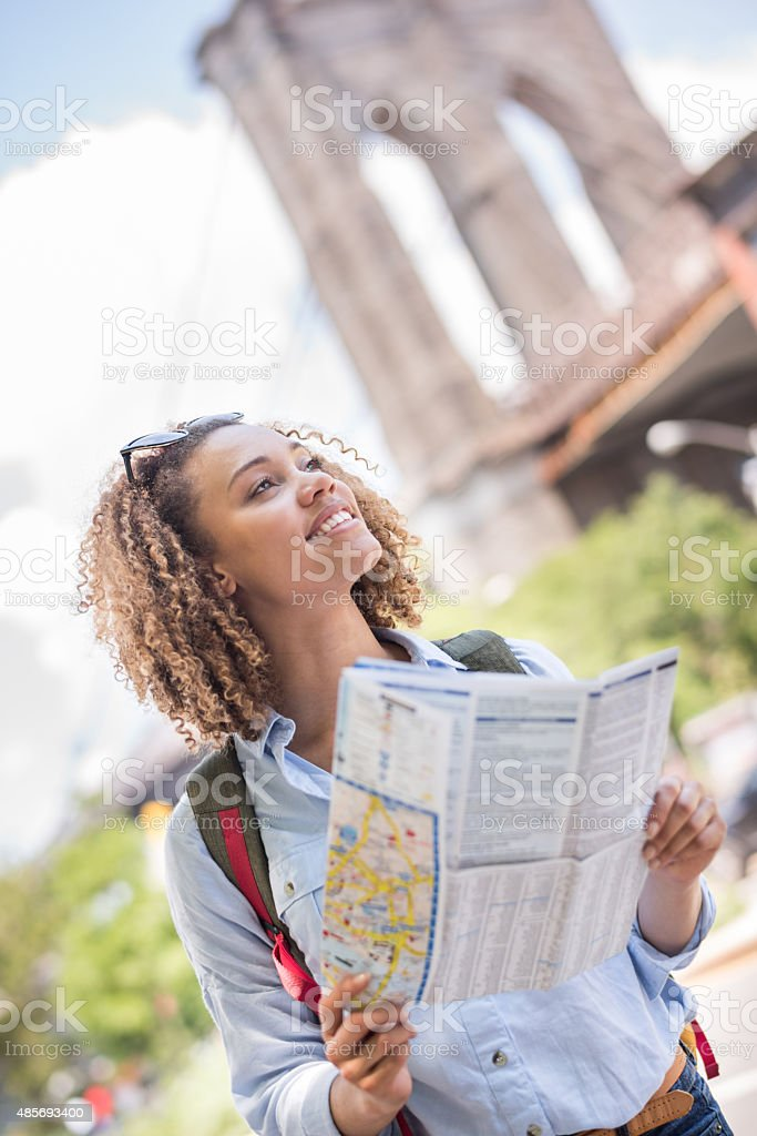 Tourist lost in New York holding a map stock photo