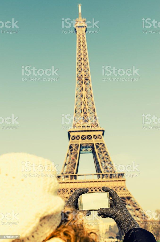 Tourist make a photo of Tour Eiffel with smartphone royalty-free stock photo
