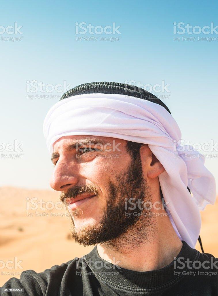 tourist man doing a selfie on the desert stock photo