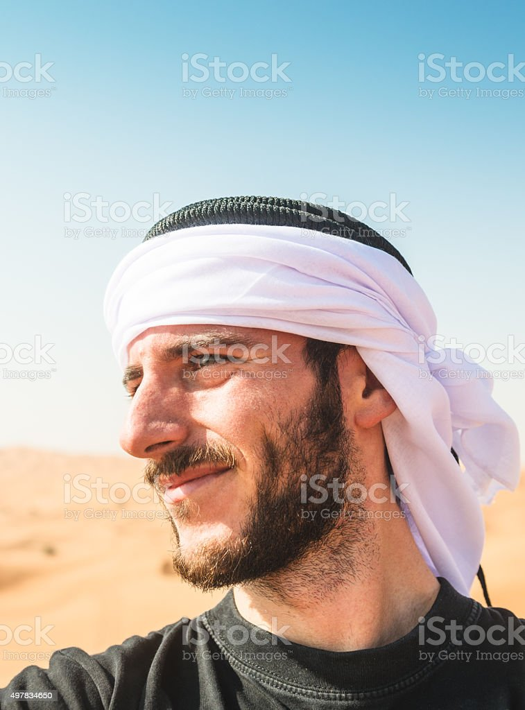 tourist man doing a selfie on the desert stock photo
