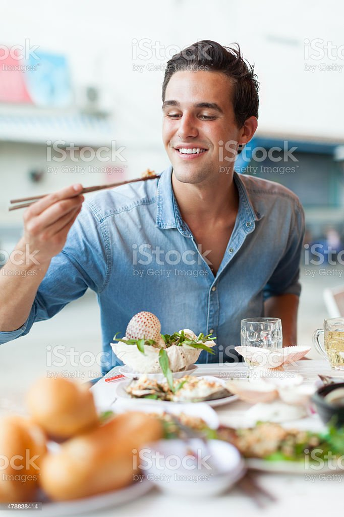 Tourist Man Eating Asian Food Street Local Cafe, Smile stock photo