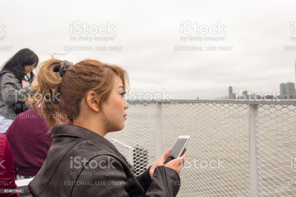 Tourist on a boat to go see the Statue of Liberty stock photo