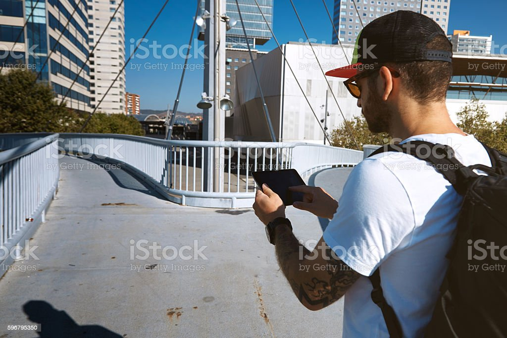 Tourist on a bridge looking for right way stock photo