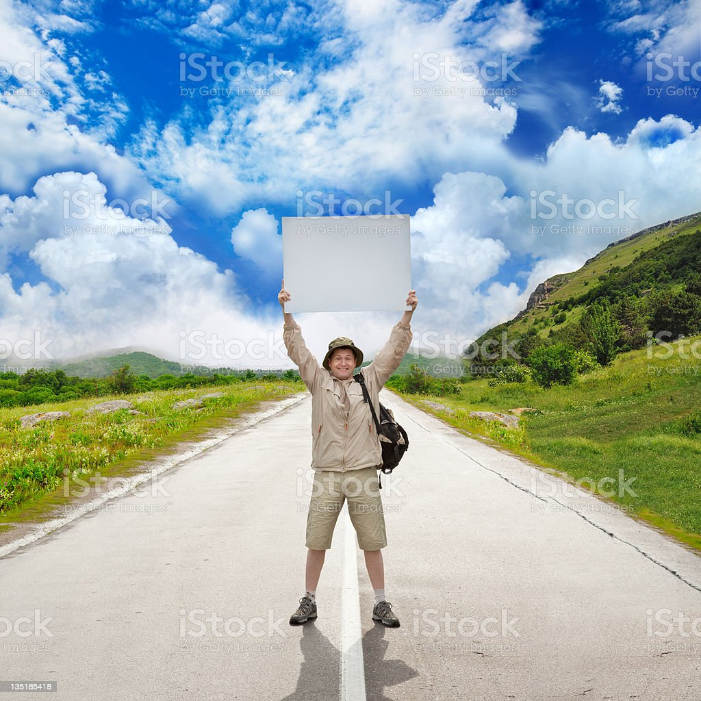tourist on a country road royalty-free stock photo