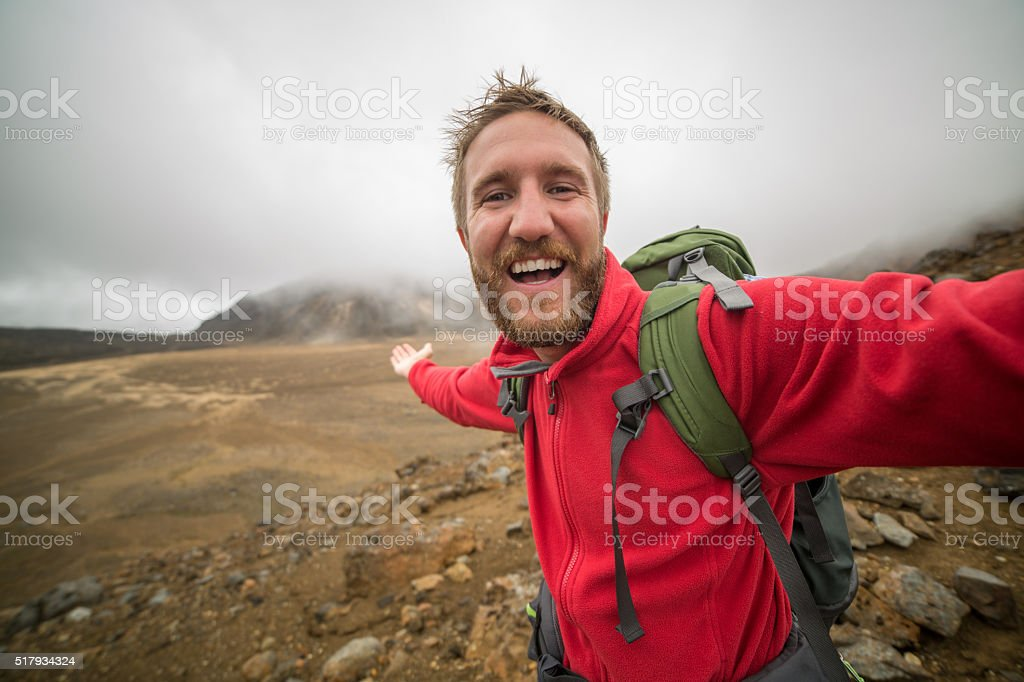 Tourist on a day hike takes a selfie portrait stock photo