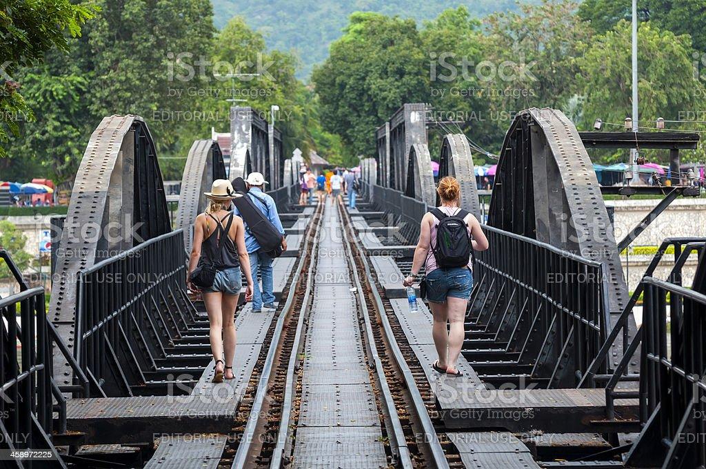 Tourist on famous bridge in Kanchanaburi, Thailand stock photo