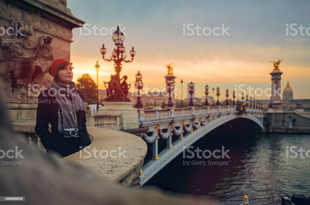 Tourist on Pont de la Concorde in Paris at dusk. stock photo