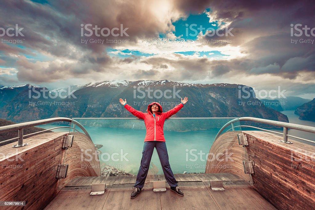 Tourist on Stegastein viewpoint, Norway stock photo