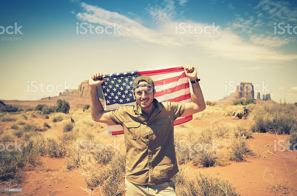 Tourist on the Monument valley with flag stock photo