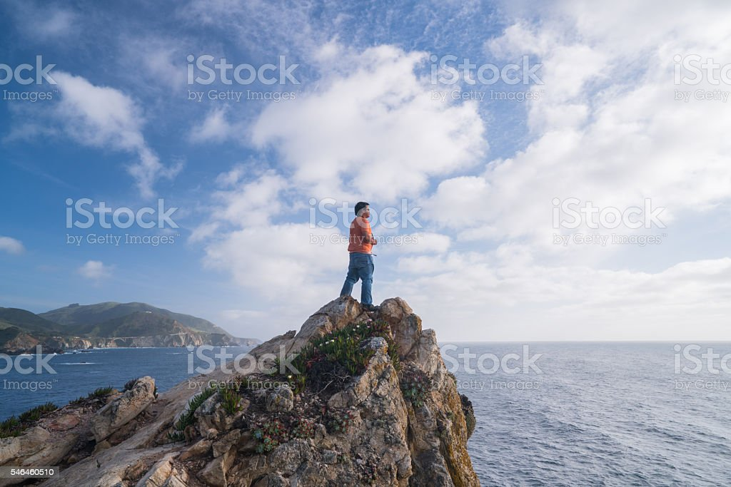 Tourist on the top of a rock near Big Sur royalty-free stock photo