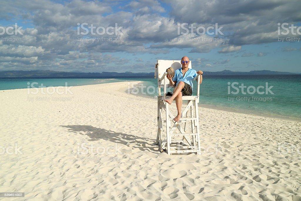 tourist on white sandy tropical beach stock photo