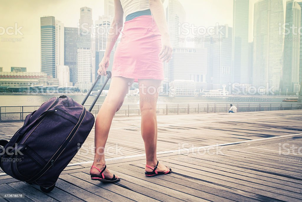 tourist or woman adventure with luggage in Singapore stock photo