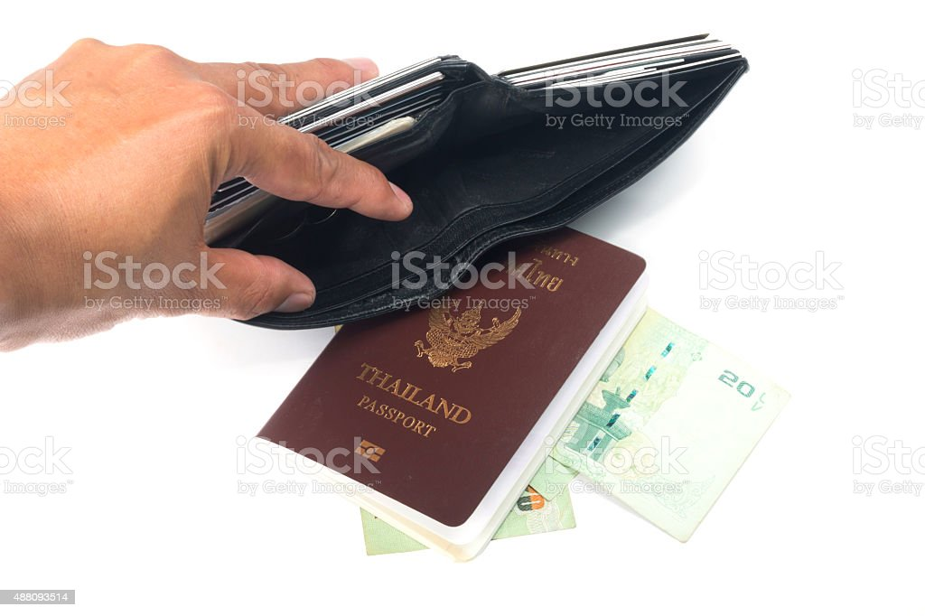 Tourist out of money and Thailand Passport stock photo