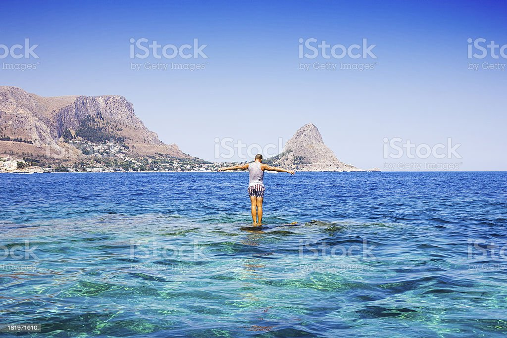 Tourist over the rock named 'La formica', royalty-free stock photo