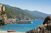 Tourist passengers getting off ferry at Monterosso al Mare, Italy