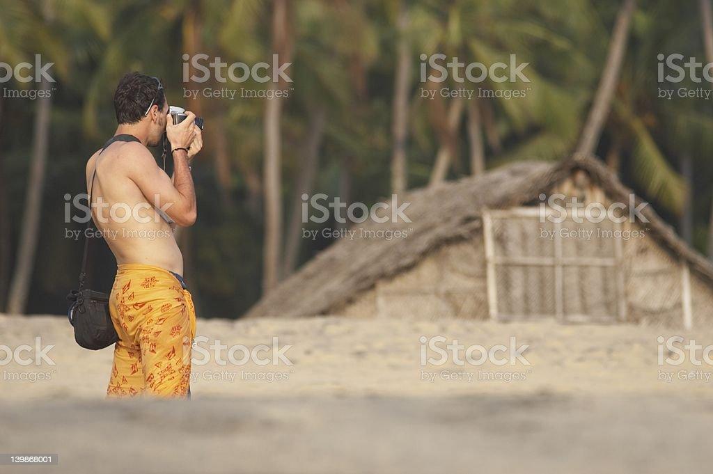 Tourist photographer on beach royalty-free stock photo