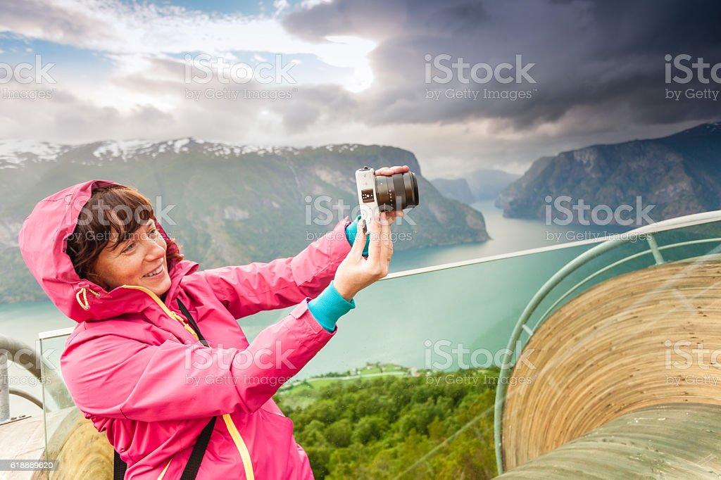 Tourist photographer with camera on Stegastein lookout, Norway stock photo