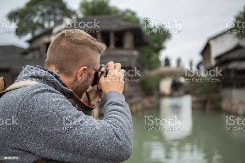 Tourist photographing Chinese village stock photo