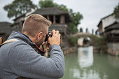 Tourist photographing Chinese village
