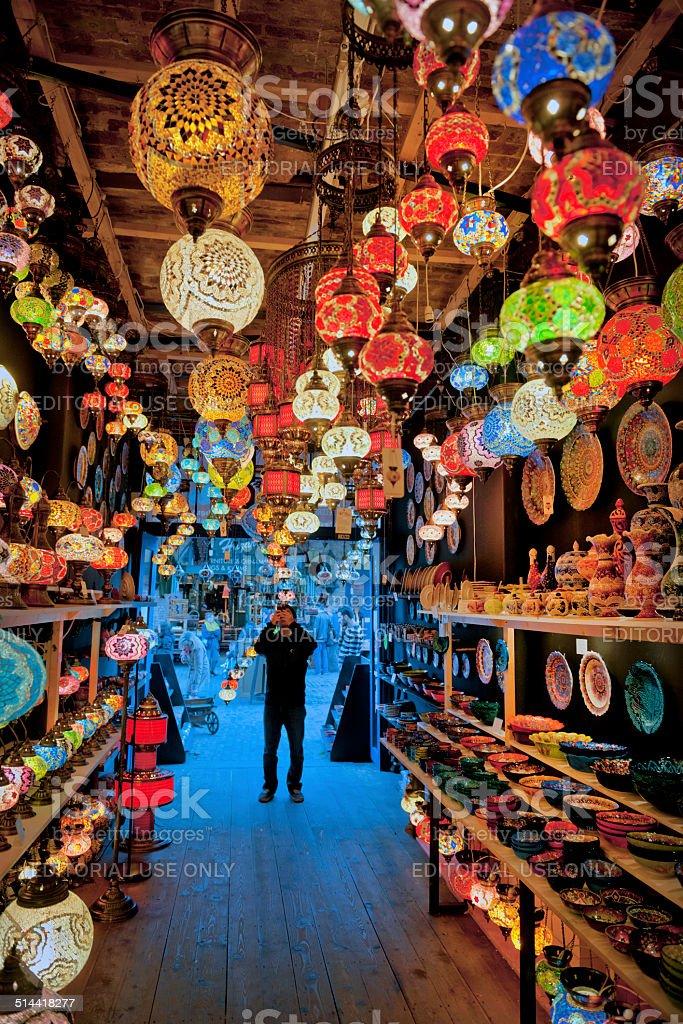 Tourist Photographing Decorative Turkish Lamps,Camden,London stock photo